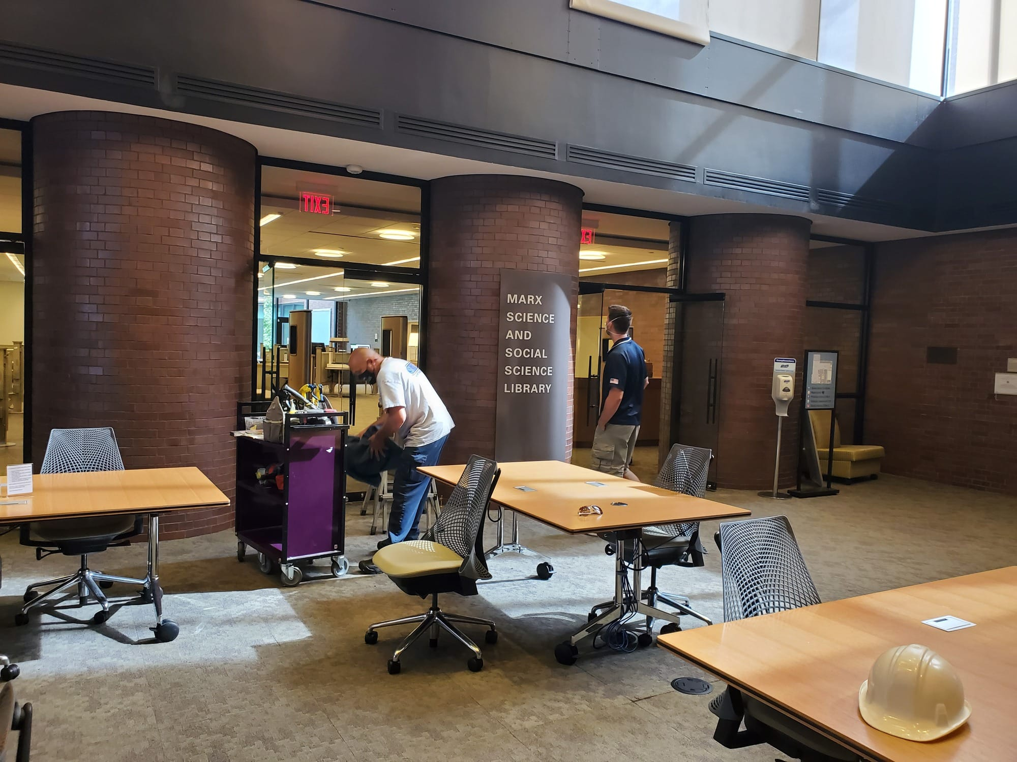 Workers installed signage reading Marx Science and Social Science Library.
