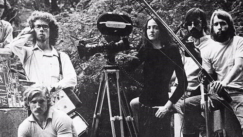 Black and white photo of Yale filmmakers standing around a movie camera mounted on a tripod