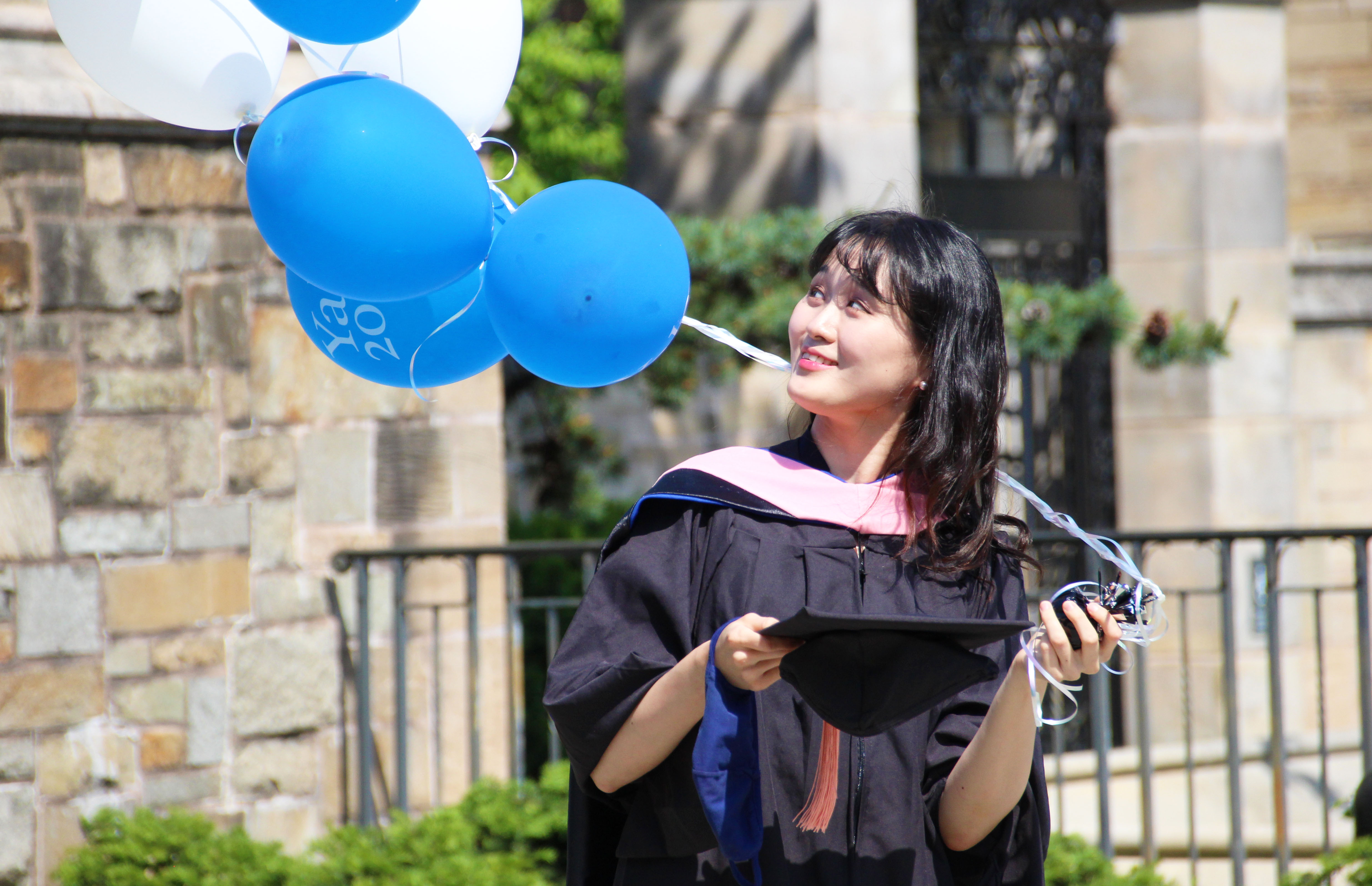 happy student with balloons