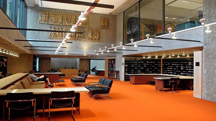 a lounging area with orange carpet