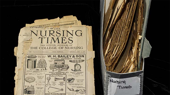 collection of artifacts and Nursing times in a binder