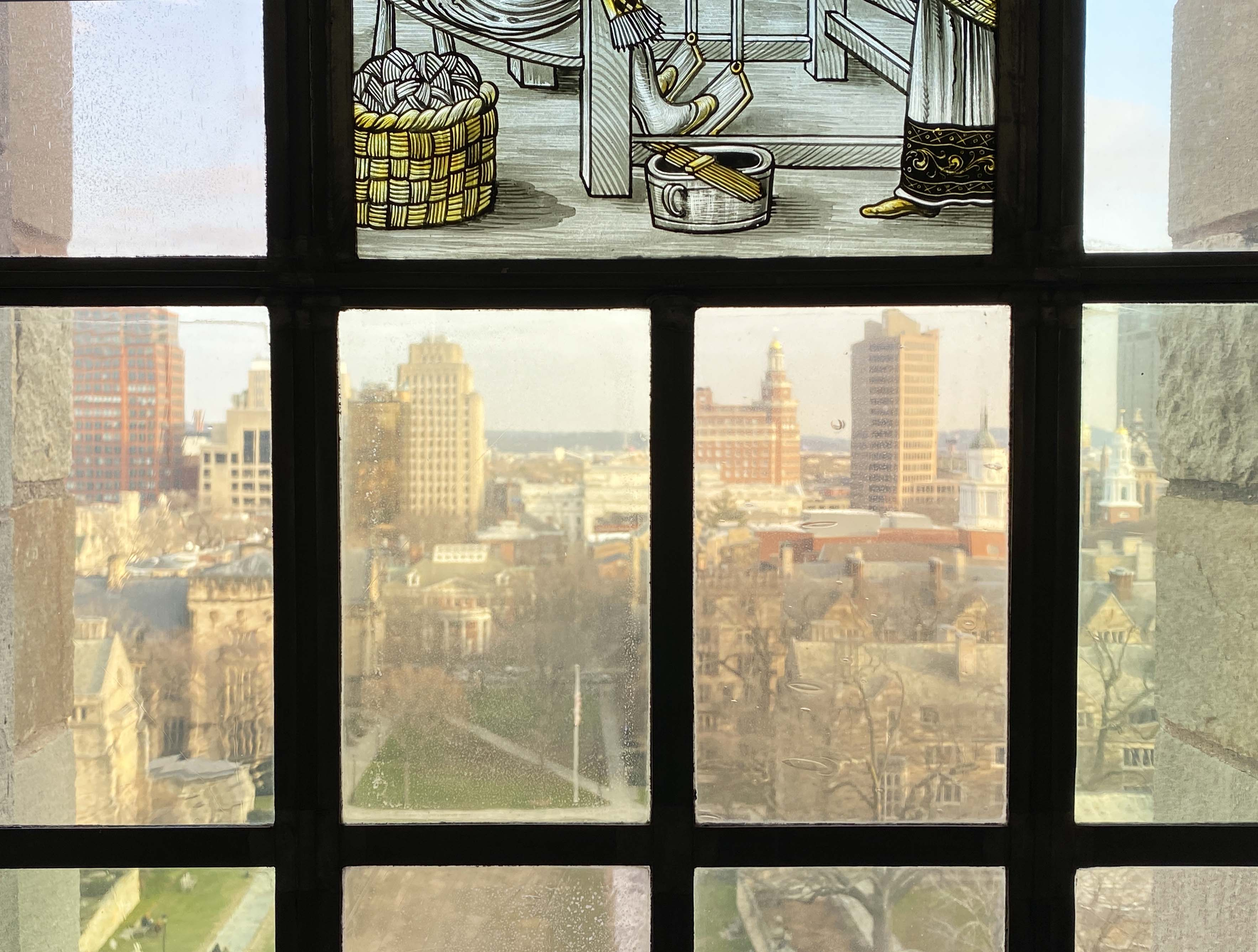 View of Yale campus through stained glass window