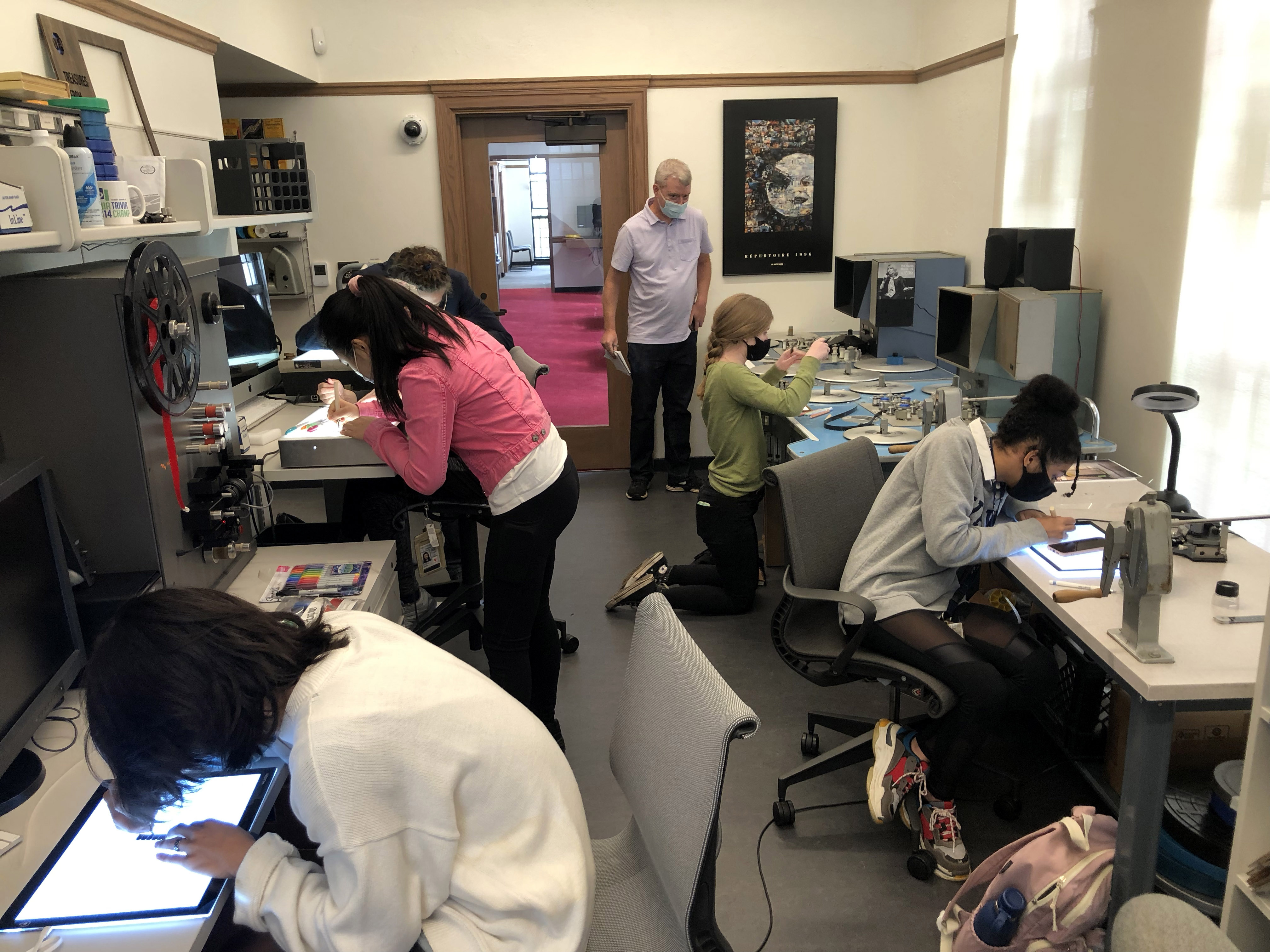 A class at work in the film conservation lab