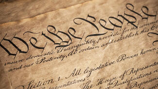 """A photo of the U.S. Constitution with the words """"We the people."""""""