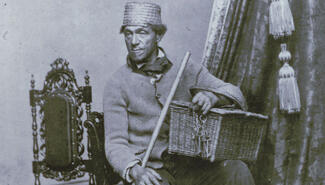Man with a broom and a basket