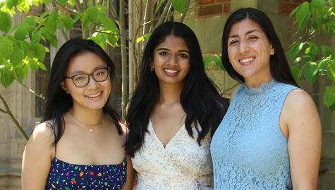 Three female Yale students smiling for a photo