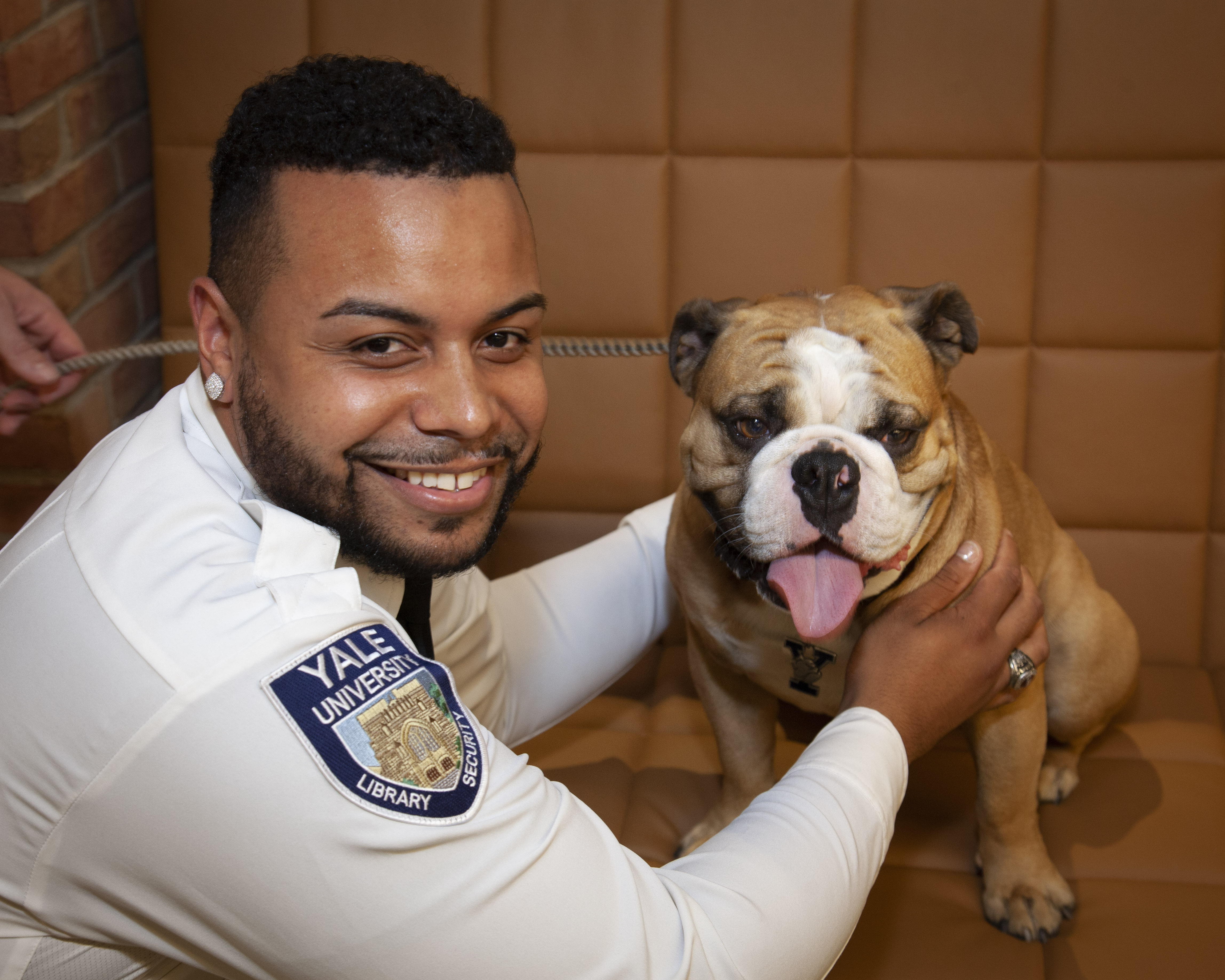 Library security officer Kenny White with Handsome Dan